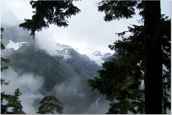Brief View of Olympus Glaciers thru clouds