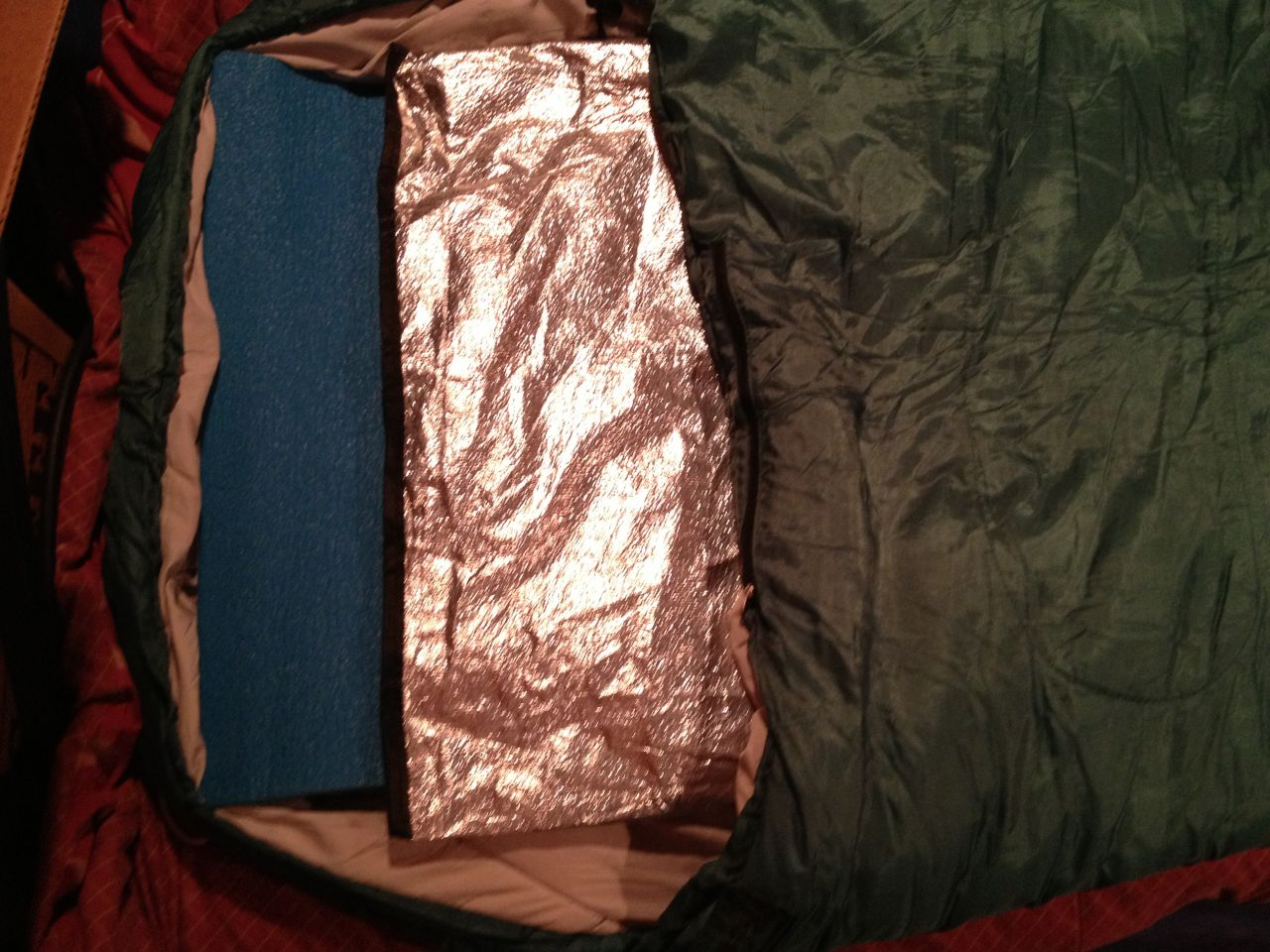 Reflective Foil Tarp And Blue Ccf Pad In An Old Sleeping Bag