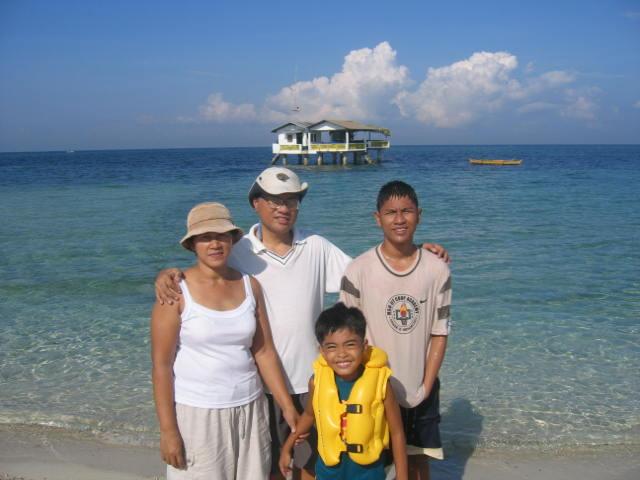 family on a sandbar