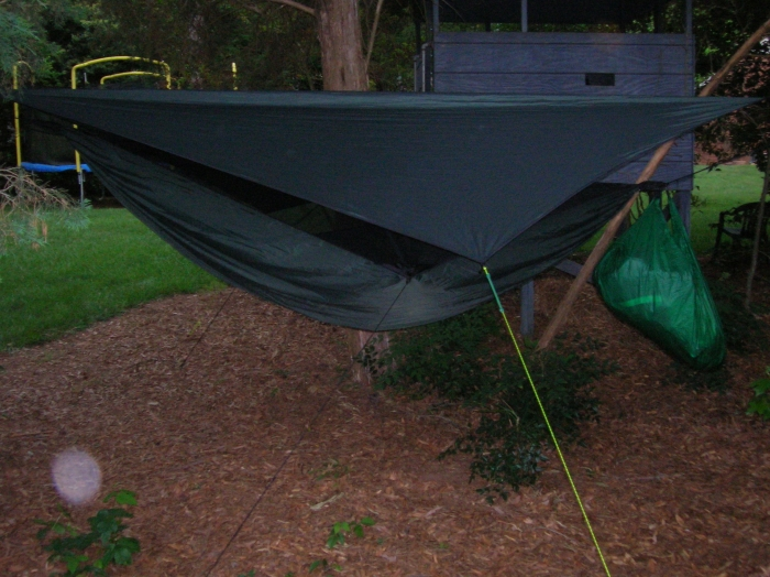 This is how I sleep at night, so the pack hammock wont pull on the tieouts