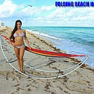 Girl standing in front of Folding Beach Hammock by telebeep in Hammocks