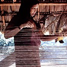 Waiwai woman weaving a hammock by jellyfish in Hammocks
