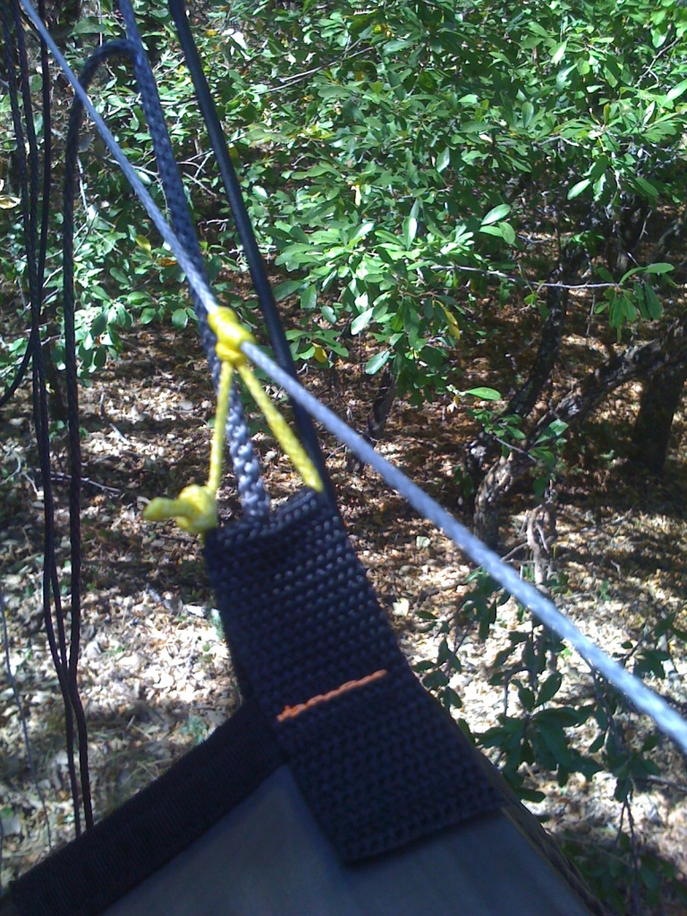 Single tarp ridge line with prussic knot soft shackle